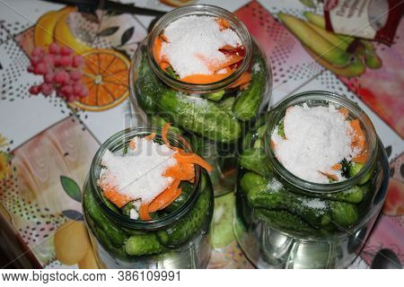 Cucumbers In Jars Prepared For Canning, Shot Close-up On A Clear Sunny Day. Can Be Used As A Backgro