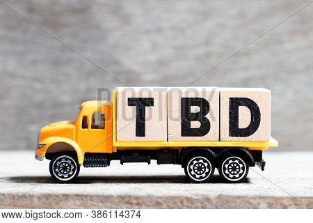 Truck Hold Letter Block In Word Tbd (abbreviation Of To Be Defined, Discussed, Determined, Decided,