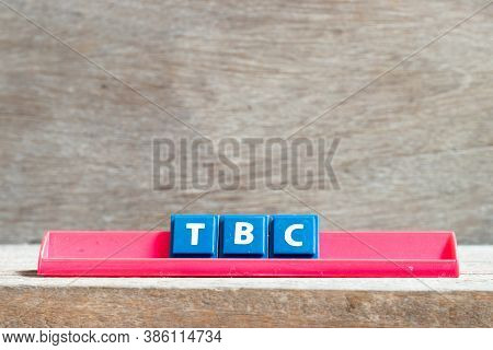 Tile Letter On Red Rack In Word Tbc (abbreviation Of To Be Confirmed Or Continued) On Wood Backgroun