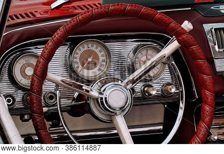 Part Of The Interior Of An Oldtimer Sports Luxury Car With Steering Wheel, Speedometer, Fuel, Clock