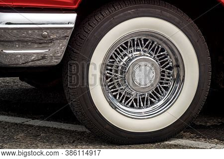 Shiny Chrome Spoked Wheel Disk With Painted In White Tire Of Red Old Timer Luxury Sports Car