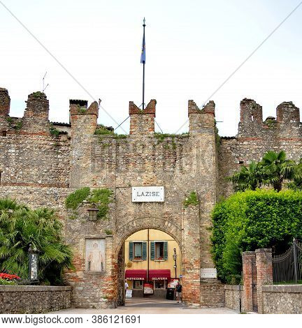Lazise, Italy 06 13 2016: Medieval City Antique Entrance Fortress Walls