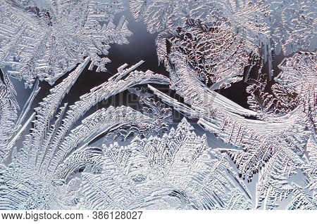 Ice And Frost On A Window Glass In Winter. The Drawing Is Similar To A Thicket Of Magic Plants. Crys