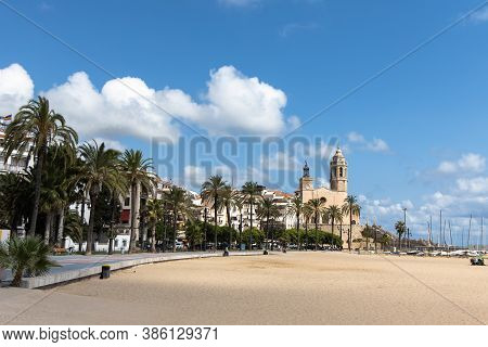 Empty Promenade Passeig De La Ribera With The Views Of Church Sant Bartomeu Y Santa Tecla, Sitges, C