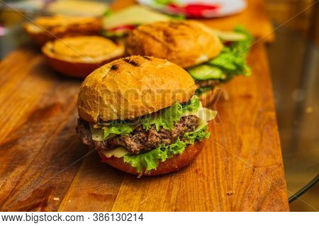 Two Homemade Grilled Hamburgers On Wooden Board. Homemade Burgers