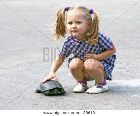 a little girl with the turtle at summertime ** Note: Slight blurriness, best at smaller sizes poster