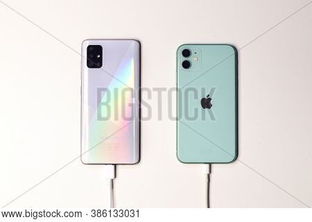 Saint-petersburg, Russia - 09.09.20: Apple New Smartphone Green Iphone 11 And Samsung Mobile Phone A