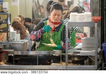 Taipei, Taiwan - September 20: Unnamed Busy Food Vendor Prepares Order For Customers At Dinner Time