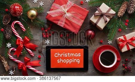 Christmas Shopping Online.tablet With Text Christmas Shopping On Red Background Among Holiday Decor
