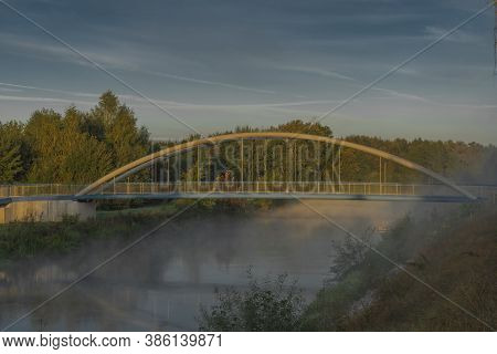 Vltava River With Bike Bridge And Small Port In Summer Cold Morning With Sun