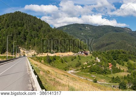 Dramatic Landscape View On Mountains, Meadow, Hills And Small Village Houses And Dam In Tara Nationa