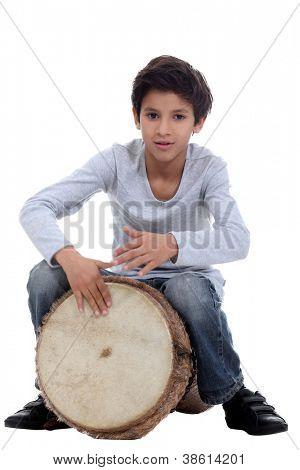 Boy playing a djembe