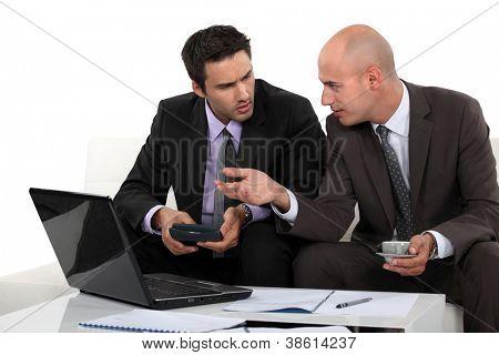 Two businessmen preparing proposal