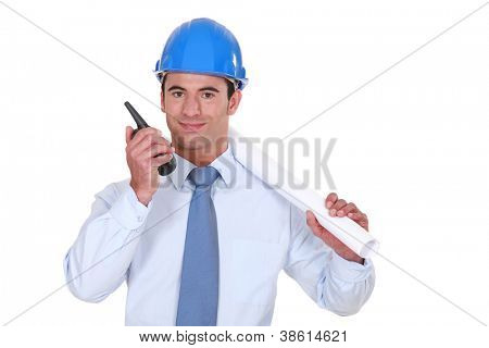 Architect with a two-way radio poster