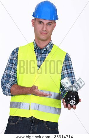 Manual worker holding piggy-bank poster