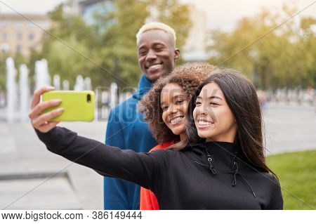 Multi Ethnic Friends Outdoor Taking A Selfie On Smartphone. Diverse Group People Afro American Asian