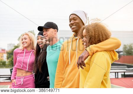 Multi-ethnic Group Teenage Friends. African-american Asian Caucasian Student Spending Time Together