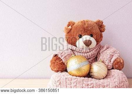 Teddy Bear In Knitted Sweater With Xmas Baubles