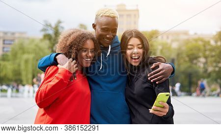 Multi Ethnic Friends Outdoor Looking Smartphone Screen. Diverse Group People Afro American Asian Spe