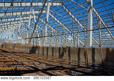 Steel Frame Of A Building Under Construction. The Construction Of The Building Is Made Of Steel Beam