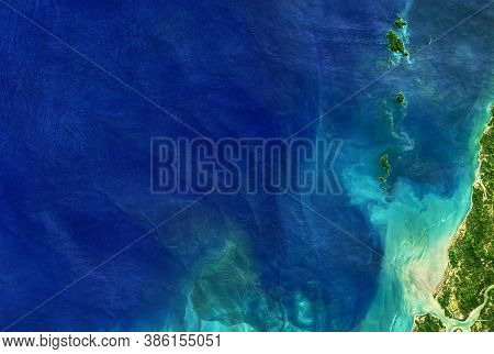 Sea Taken From Space, Detailed Earth Surface On Global Satellite Photo. Aerial Top View Of Blue Ocea
