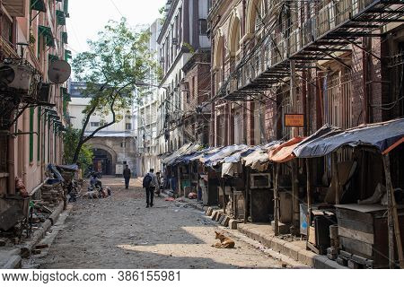 Kolkata, India - February 1, 2020: A Few Unidentified People In A Local Alleyway With Closed Market