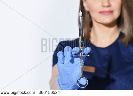Close-up Of Woman Dentists Hand In Glove With Syringe Full Of Anesthesia For Pain Relief Injection B