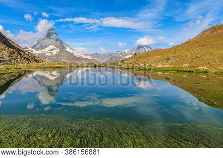 Reflection Of Mount Matterhorn On Riffelsee Lake In Zermatt, Mountain Resort In Swiss Alps, Canton O