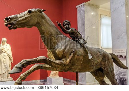 Athens - May 7, 2018: Bronze Statue Of Horse And Young Jockey In National Archaeological Museum Of A