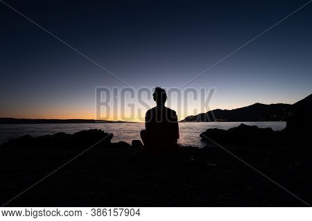 Silhouette Girl On The Sky Background During Sunset. Yoga And Meditation. A Place For Rest And Relax