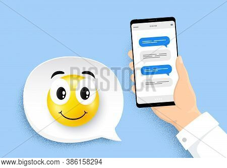Hand Holding Phone With Online Messages. Smartphone With Chatting Bubbles. Happy Smile Face. Speech