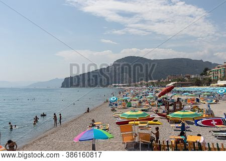 Italy, Finale August 2020: Buys Beach With A Lot Of People Spending Their Holiday In Finale Liguria