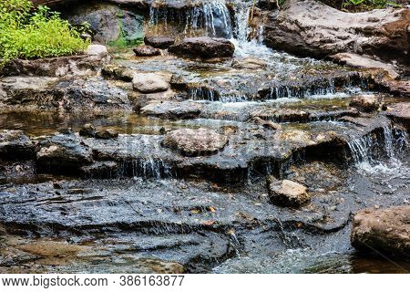 Water running over rocks close up