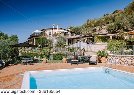 Luxury Country House With Swimming Pool In Italy, Couple On Vacation At Luxury Villa In Italy, Men A