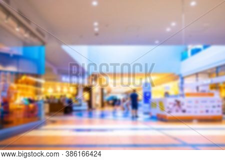 Shopping Center Interior Blurred Background. People Shopping In Modern Commercial Mall Center. Inter