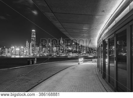 Seaside Promenade Of Victoria Harbor Of Hong Kong City At Night