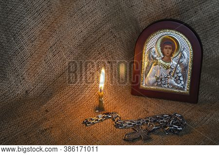 Icon Of The Archangel Michael With Silver And Gilding, A Pectoral Cross And A Burning Candle. Large