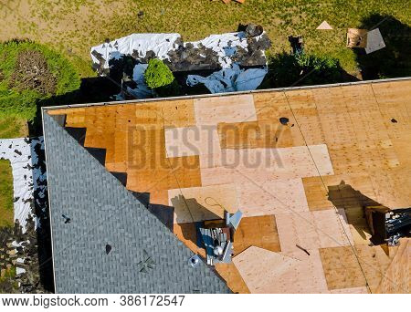 A Roofer Nailing Shingles With Air Gun, Replacing Roof Cover Protection Being Applied, Apartment Dev