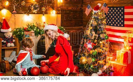 My Dear Baby Santa. Family Having Fun At Home Christmas Tree. Family Holiday. Happy Family. Mom And