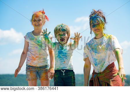Cheerful Kids Showing Her Hands Painted In Bright Colors. Colorful Faces, Color Splash, Coloured Pow