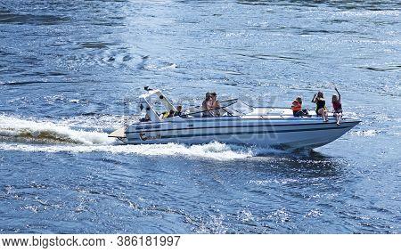 Umea, Norrland Sweden - June 16, 2020: Family Rides Motorboat On The River