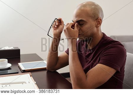Businessman Massaging Nose Bridge Feeling Fatigue, From Headache Or Eye Tension After Working Too Lo