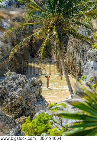 Tulum, Yucatan Peninsula, Mexico, October 31, 2015: Tourists on the Beach.