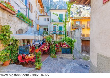 LIMONE, ITALY, JUNE 20, 2017: STREET RESTAURANTS IN THE CENTRE OF LIMONE.