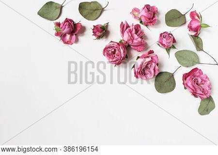 Feminine Wedding Desktop Composition With Pink Roses Flowers, Dry Green Eucalyptus Leaves Isolated O
