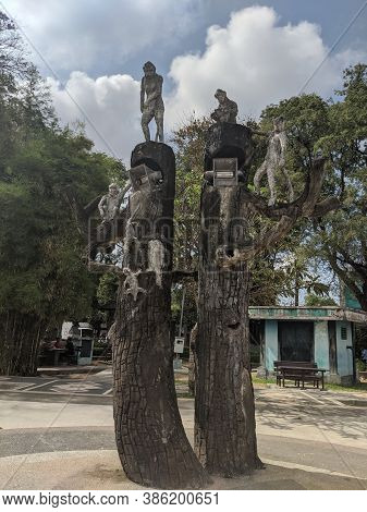 Denpasar, Indonesia - September 28, 2019: An Open Space Area With Artwork Of Monkey Statues Around P