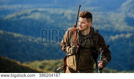 Male With A Gun. Hunter With Hunting Gun And Hunting Form To Hunt. Hunt Hunting Rifle. Hunter Man. H