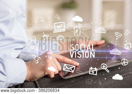Close-up Of A Person Using Social Networking with SOCIAL VISION inscription