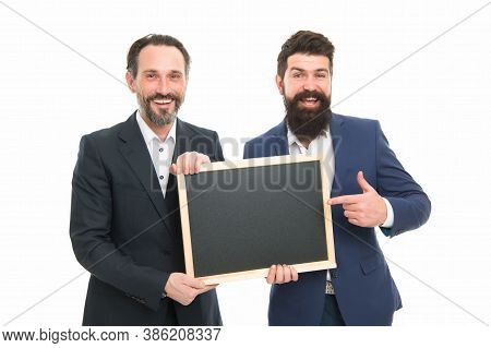 Your Logotype Here. Happy Men Pointing Fingers Isolated On White. Marketing Experts Pointing At Blac