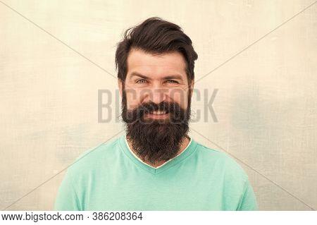 Man Bearded Hipster Stylish Beard Grey Background. Stylish Beard And Mustache Care. Happy Face. Hips